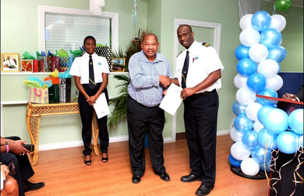 SAINT-LUCIA: The Comptroller awards a Certificate of Merit to one of the Customs officers.
