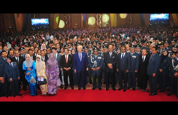 MALAYSIA : The Hon. Prime Minister of Malaysia, Dato' Sri Mohd Najib, with Royal Malaysian Customs staff during the ICD 2018 celebration at the Putrajaya International Convention Centre.