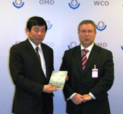 Kunio Mikuriya, the Secretary General of the WCO, receives a book on Customs Cooperation in the Community of Portuguese-Speaking Countries (CPLP) from Francisco Curinha, the Secretary General of the Conference of CPLP Directors General of Customs and Director of Cooperation and Institutional Relations at the Portuguese Customs administration