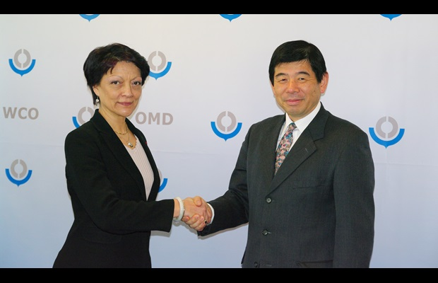 The Secretary General of the WCO, Kunio Mikuriya, shakes hands with the President of INTERPOL, Ms. Mireille Ballestrazzi