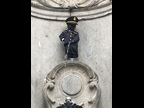 Belgium's iconic Manneken-Pis statue is dressed in a Customs officer's uniform to celebrate International Customs Day