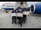 UK Border Force officers posing with boxes containing the iguanas at Heathrow before boarding a flight to Nassau. As the species is so incredibly rare, special dispensation was given to carry them in the main cabin of the aircraft. Photo credit Steve Parsons/PA