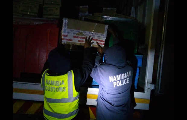 Namibia Customs and Police working together to inspect a truck cargo.