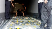 223 packages of cocaine were concealed in a special compartment in the floor of the container