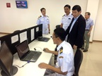WCO Secretary General Mikuriya looking at the Myanmar Automated Cargo Clearance System (MACCS) during his visit to the Thilawa Special Economic Zone
