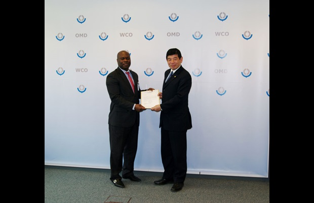 WCO Secretary General Mikuriya receiving from Chargé d'Affaires Américo Afonso Lima Viegas the instruments of accession of Sao Tome and Principe to the RKC