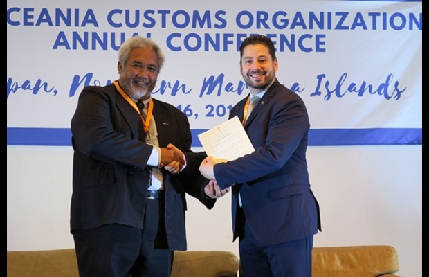 Mr. Tingika Elikana, Associate Minister of Finance of Cook Islands depositing the instrument of accession to the RKC