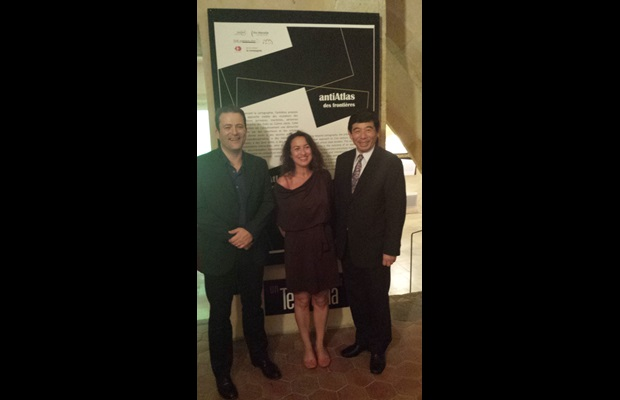 "WCO Secretary General Kunio Mikuriya with Isabelle Arvers, Exhibition Curator, as well as with Cédric Parizot, political anthropologist for the Mediterranean Institute of Advanced Research (IMéRA), at the opening of the ""antiAtlas of Borders"" International Research Conference and Art-Science Exhibition, on 30 September 2013"