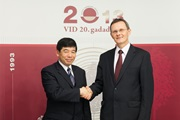 Secretary General Kunio Mikuriya with the Latvian Minister of Finance, Mr. Andris Vilks, on 30 October 2013 in Riga, Latvia