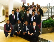 WCO Secretary General Mikuriya accompanied by the Fellows and the two programme facilitators: Ms. Khathutshelo Tshikosi from the South African Revenue Service, on his left, and Mr. Rob Jansen from the WCO, second on his right, same row.