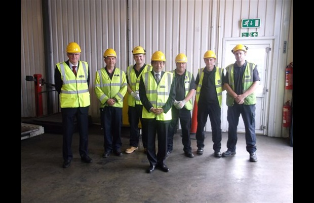 Secretary General with British colleagues at the Port of Tilbury examination area.
