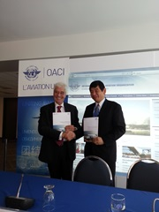 "The Secretaries General of the ICAO, Mr. Raymond Benjamin and the WCO, Mr. Kunio Mikuriya, at the launch of a joint ""Moving Air Cargo Globally"" brochure during the 38th ICAO Assembly, in Montreal, Canada, on 24 September 2013"