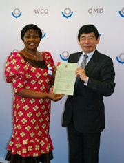 The Ambassador of the Republic of Malawi, Her Excellency Dr. Brave Ndisale, presents Secretary General Kunio Mikuriya with Malawi's instrument of accession to the Revised Kyoto Convention.