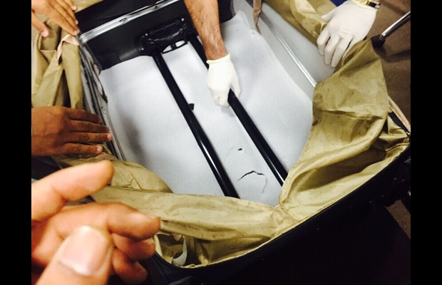 Dubai Customs officers uncovering 9.2 kg of heroin concealed in the lining of a passenger's bag
